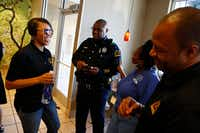 Dallas police Chief Renee Hall (left) laughs with Officer Mitchell Gatson; Michelle Lowe, neighborhood code representative; and Mandrell Drakes, community outreach representative, at a Dallas police community outreach event on Sept. 9 at a McDonald's in the Northeast Division patrol area.(Nathan Hunsinger/Staff Photographer)