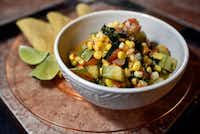Squash with chicken and vegetables cooked by the Quinones family (Ben Torres/Special Contributor)