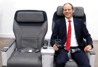 Mark Hiller, CEO and shareholder of Recaro Aircraft Seating, poses in a new aircraft seat made for Alaska Airlines on Tuesday in Fort Worth.(David Woo/Staff Photographer)