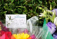 Bouquets of flowers and notes left near the scene of a shooting at the 1700 block of West Spring Creek Parkway in Plano on Tuesday, September 12, 2017. Shooting took the lives of eight victims.(Vernon Bryant/Staff Photographer)