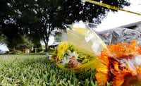 Flowers sit at a makeshift memorial for the victims lost in a shooting at the 1700 block of West Spring Creek Parkway in Plano. (Vernon Bryant/Staff Photographer)
