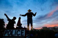 As the sun set on the last day of the State Fair of Texas in 2016, Dallas police officer Brent Carter gave a lost little boy directions from atop his perch at Big Tex Circle.(File Photo/Tom Fox)