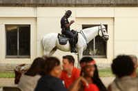 Dallas Police officer Andre Taylor patrols with the mounted unit behind the Texas Hall of State on the last day of the 2012 State Fair of Texas.(File Photo/Staff)