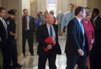 "<p>House Ways and Means Committee Chairman Kevin Brady, R-Texas, center, has pledged to ""continue to reward homeownership.""&nbsp;</p>(J. Scott Applewhite/The Associated Press)"
