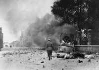 Smoke and debris in a street of Dunkirk, France,  June 1940.  (File Photo/The Associated Press)