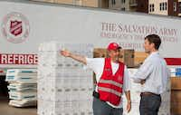 Captain Harold Laubach Jr., a pastor with the Salvation Army, speaks with Food for Good s Matt Smith about logistics in getting meals to one of the Houston neighborhoods ravaged by Hurricane Harvey. The first of PepsiCo s one million meals committed to Southeast Texas arrived just after Labor Day.(Beatriz Terrazas/Courtesy)