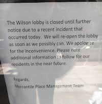 A sign on the door at the Wilson Building in downtown Dallas, where a man reportedly cut two women with a pocketknife Sunday afternoon.(Allan James Vestal/Staff)