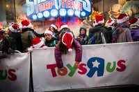 "<p><p><span style=""font-size: 1em; background-color: transparent;"">Black Friday shoppers wait to enter the Toys ""R"" Us store in New York's Times Square. The retailer filed Chapter 11 documents late Monday.</span></p></p>(2014 File Photo/Getty Images)"