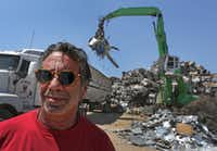 Laviage stands in the yard of his business, C&D Scrap Metal Recyclers in Houston.(Louis DeLuca/Staff Photographer)