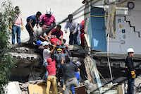 A woman is pulled out of the rubble alive following a quake in Mexico City on Tuesday.(Ronaldo Schemidt/AFP/Getty Images)