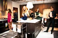 A cocktail party in someone's kitchen? Hardly: It's a photo shoot at Ikea in Frisco before these teenagers went to homecoming. That's (from left) Casey Ehrman, Zach Pajela, Adrienne Romney, Marco Cardona, Megan Goulding and Harrison McFarland. Where are the others? Probably lounging in the fake room nearby.(<p>Courtesy</p>/Shandee Goulding)
