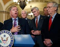 Sen. Lindsey Graham, R-S.C., speaks to the media, accompanied by Senate Majority Whip Sen. John Cornyn, R-Texas, Sen. Bill Cassidy, R-La., Sen. John Thune, R-S.D., and Senate Majority Leader Mitch McConnell of Kentucky on Capitol Hill on Sept. 19, 2017, in Washington.(Alex Brandon/The Associated Press)