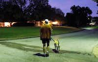 "<p><span style=""font-size: 1em; background-color: transparent;"">Dr. Alan Johns walks his dog, Zoe, on one of their thrice-weekly predawn walks. The Fort Worth gynecologist had breast cancer 20 years ago. He was in shape then, and he is now. Having it, he says, ""was merely a blip in my fitness regimen.""</span></p>(David Woo/Staff Photographer)"