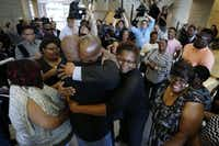 John Nolley (center, facing camera) was embraced by his brother LaMarcus Nolley and sister Mia Nolley after he was released from prison in 2016.(Paul Moseley/The Associated Press )