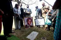 Members of Tim Cole's family stood with his mother, Ruby Session (center) at his grave site at Mount Olivet Cemetery in Fort Worth after receiving pardon documents from Gov. Rick Perry in March 2010. (File Photo/The Associated Press)