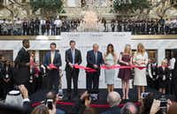President Donald Trump cut the ribbon with his wife and children during an event celebrating the opening of the Trump International Hotel in Washington last October.(File Photo/The New York Times)