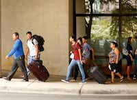 """Evacuees from South Texas arrived at the """"mega shelter"""" outside the Kay Bailey Hutchison Convention Center in Dallas on Aug. 29.(Rose Baca/Staff Photographer)"""