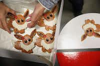 Jana Gibson of Arlington drops off her Pokemon-themed cookies during the 21st annual Holiday Cookie Contest at Central Market in 2016. (Andy Jacobsohn/Staff Photographer)