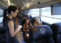 Vonlane buses provide free Wi-Fi and an onboard attendant serves complimentary snacks, meals, and refreshments. It also offers leather seats with ample legroom. (David Woo/The Dallas Morning News)