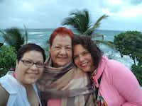 """<p>Enid Reyes (right) says family members Melinda Reyes (left) and Hilda Reyes (center)<span style=""""font-size: 1em; background-color: transparent;"""">took shelter from Maria at their home near San Juan.</span></p>(Enid Reyes)"""