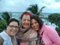 "<p>Enid Reyes (right) says family members Melinda Reyes (left) and  Hilda Reyes (center)<span style=""font-size: 1em; background-color: transparent;""> took shelter from Maria at their home near San Juan.</span></p>(Enid Reyes)"