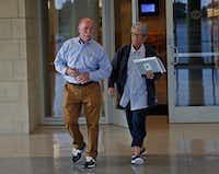 Gary Bardwell (left) and his wife, Gina Capley, leave the Collin County Courthouse on Wednesday after Jason Lowe was sentenced to 50 years in prison for murdering their daughter, Jessie Bardwell. (Jae S. Lee/Staff Photographer)