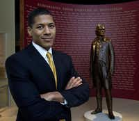 "Shannon Lanier poses at the Smithsonian's National Museum of American History in Washington in 2012 at the exhibit ""Slavery at Jefferson's Monticello: Paradox of Liberty."" Lanier is a descendant of Thomas Jefferson's slave Sally Hemings.  (Manuel Balce Ceneta/The Associated Press)"