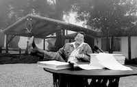 President Ronald Reagan signed tax cuts into law in 1981 at his California vacation home, Rancho del Cielo, near Santa Barbara.(File Photo/The Associated Press)