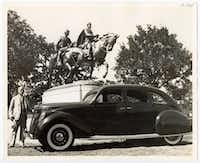 "Alexander Phimister Proctor, the New York sculptor who produced the statue of Robert E. Lee, is shown beside his new Lincoln-Zephyr named ""Traveller"" after the Confederate general's horse. The statue was unveiled June 12, 1936, by President Franklin D. Roosevelt, who was in town to speak at the Texas Centennial Exposition at Fair Park that day.(DeGolyer Library/Southern Methodist University)"