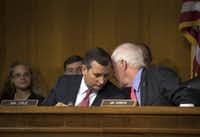 Texas Sens. Ted Cruz and John Cornyn confer during a subcommittee meeting in 2016.(Stephen Crowley/The New York Times)