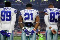 Dallas Cowboys players Charles Tapper, Ezekiel Elliott and Terrance Williams stand for the national anthem before their season opener against the New York Giants on Sept. 10 at AT&T Stadium in Arlington. (Tom Fox/Staff Photographer)