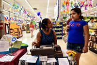 <p>Typewriter poet Fatima-Ayan Malika Hirsi, 29, of Dallas visits with Alexa Rodriguez, 10, as they work together to write a poem about Alexa inside El Rancho supermarket in Pleasant Grove.</p>(Ben Torres/Special Contributor)