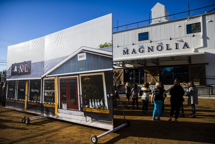 A Large Photo Of The Original Location Stands Outside New Magnolia Market At Silos Owned By Chip And Joanna Gaines
