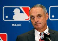 Commissioner Rob Manfred is scheduled to be in town Thursday when the Rangers break ground on their new ballpark. (Charles Rex Arbogast/The Associated Press)
