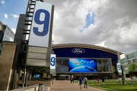 Tony Romo's number was put on the screens at Tostitos Plaza in front of the Ford Center at The Star in Frisco in April.(Stewart F. House/Special Contributor)