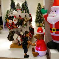 Raul Trejo plays with a blow up bear in the holiday section of J. C. Penney at Collin Creek Mall in Plano, Texas on Sept. 26, 2017.(Nathan Hunsinger/Staff Photographer)