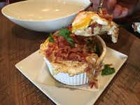 Brunch at Sinclair reveals inspired dishes, like macaroni-and-cheese gilded with an over-easy egg.(June Naylor)
