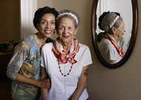 Leena Sanders, left, pose with her mother, Ruth Sanders, in Ruth's home on Monday, March 14, 2016. Ruth Sanders, 93, is in the early stages of dementia. While she can discuss the history of her neighborhood clearly and vividly, she does not understand that a large brokerage firm is currently suing her to collect money on a contract she signed in 2013 to sell her house. Whether Ruth was mentally competent when she signed the contract is a matter of debate in the lawsuit, which her family cannot afford to keep fighting, and cannot afford to pay damages on if she lose. (Staff Photographer/David Woo)