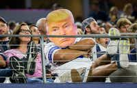 A Dallas Cowboys fan dressed as Donald Trump watches their game against the Philadelphia Eagles from the stands on Oct. 30, 2016 at AT&T Stadium in Arlington, Texas.(Ashley Landis/Staff Photographer)