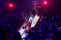 The cast of Dallas Theater Center's <i>Hair </i>come down the slide at the Wyly Theatre.(Lawrence Jenkins/Special Contributor)