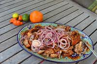 A platter of cochinita pibil, Yucatan slow-cooked pork, fresh from the slow cooker.(Cathy Barber/Special Contributor)