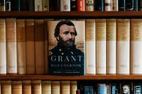 Ron Chernow's 32-volume collection of Ulysses S. Grant papers lines a bookshelf in his office. (Michael Rubenstein/For The Washington Post)