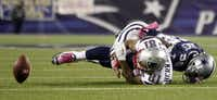 Dallas Cowboys inside linebacker Bradie James (56) stripped the ball from New England Patriots tight end Aaron Hernandez (81) in a 2011 game. Hernandez later committed suicide while on trial in a murder case.(File Photo/Vernon Bryant)