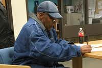 O.J. Simpson signs documents at the Lovelock Correctional Center, Saturday, Sept. 30, 2017, in Lovelock, Nev. Simpson was released from the Lovelock Correctional Center in northern Nevada early Sunday, Oct. 1, 2017.(Brooke Keast/Nevada Department of Corrections via AP)