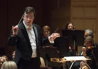 """Guest Conductor James Feddeck leads the Dallas Symphony Orchestra as they perform Beethoven's """"Concerto No. 5 in E-flat major for piano and Orchestra, Op. 73, """"Emperor"""" on Sept. 28. (Rex C. Curry/Special Contributor)"""