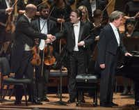 DSO Concert Master Alexander Kerr, left, shakes hands with Conductor James Feddeck, center, at right, is Pianist Rudolf Buchbinder.  (Rex C Curry/Special Contributor)