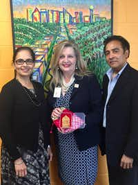 From left: Aradhana Asava, North Texas Food Bank CEO Trish Cunningham and Raj G. Asava.