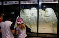 "<p>People look at the&nbsp;""Mount Muchmore""&nbsp;butter sculpture at the State Fair of Texas in Dallas on Sunday.</p>(Vernon Bryant/Staff Photographer)"