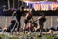 Concertgoers run after a gunman opened fire on the Route 91 Harvest Festival Sunday night in Las Vegas. The shooting left at least 50 people dead and more than 100 injured.(Getty Images/David Becker)