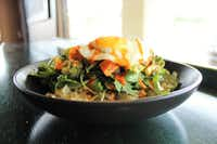 Warm Riced Cauliflower Breakfast Salad with an egg on top at Snappy Salads(Snappy Salads)